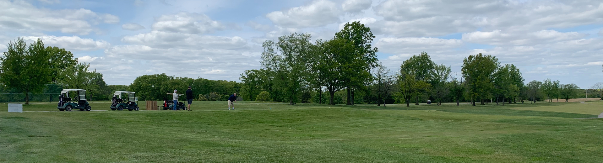 A group of golfers play the course at Warrenton